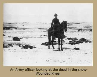 An Army officer looking at the dead in the snow - Wounded Knee